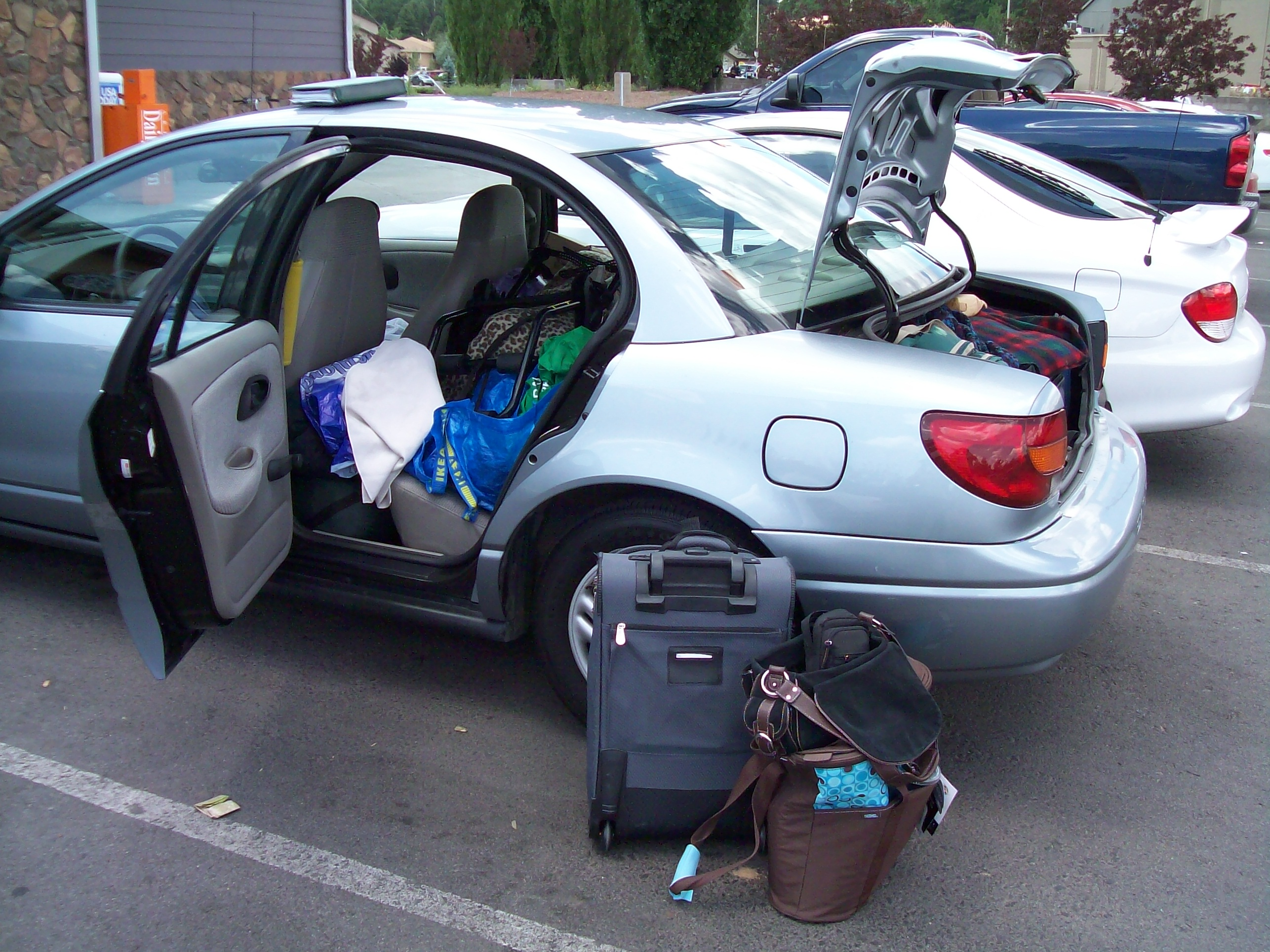 NOT the Best Way To Pack a Suitcase or Car